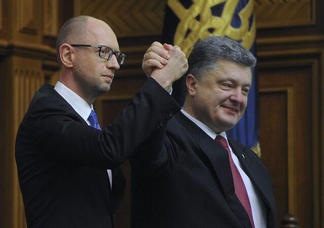 Ukraine's President Petro Poroshenko, right, celebrates with Arseniy Yatsenyuk after Yatsenyuk was appointed as Prime Minister during the opening first session of the Ukrainian parliament in Kiev