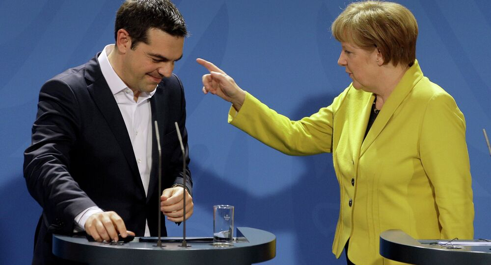 German Chancellor Angela Merkel (right) and the Prime Minister of Greece Alexis Tsipras (left) at a press conference following talks at the chancellery in Berlin, on March 23, 2015.