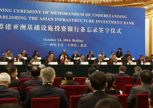 Delegates attend a signing ceremony of the Asian Infrastructure Investment Bank at the Great Hall of the People in Beijing on October 24, 2014