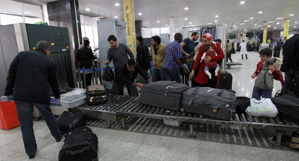 Travelers pass through security at Sanaa International Airport as hundreds of foreigners were evacuated from the Yemeni capital due to security reasons on March 28, 2015