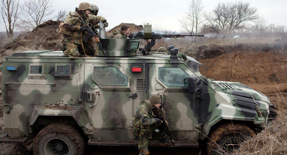 Ukrainian servicemen take part in combat drills near the southern Ukrainian city of Mariupol on February 6, 2015