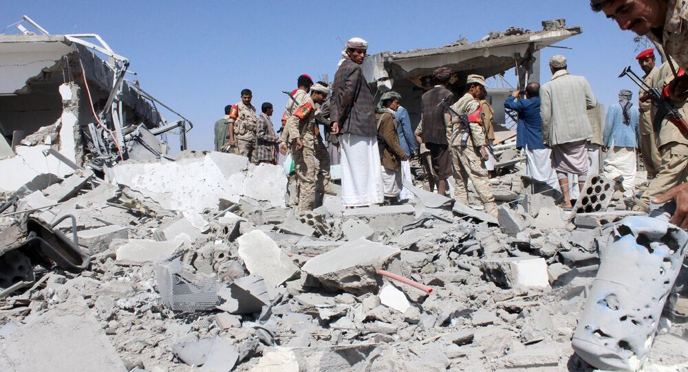 Soldiers and Houthi fighters inspect the damage caused by air strikes on the airport of Yemen's northwestern city of Saada, a Houthi stronghold near the Saudi border, March 30, 2015