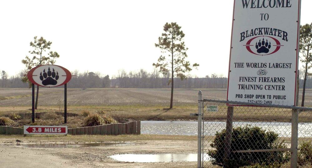 In this Feb. 20,2004 file photo, signs welcome visitors to the private North Carolina-based security company Blackwater USA's headquarters near Moyock, N.C.
