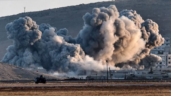Smoke rises during airstrikes on the Syrian town of Ain al-Arab, known as Kobane by the Kurds - Sputnik International