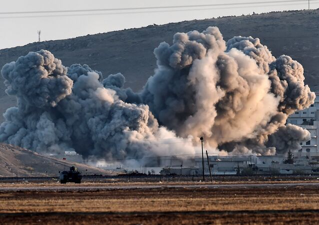Smoke rises during airstrikes on the Syrian town of Ain al-Arab, known as Kobane by the Kurds