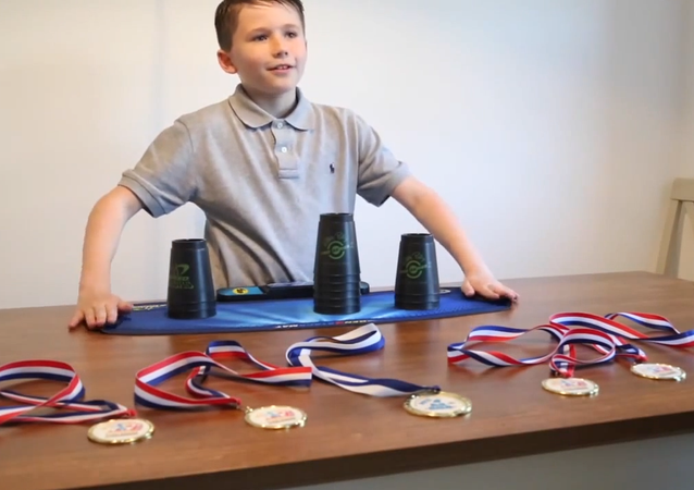 Superb Sleight of Hand: 10-Year-Old UK Speed Stacking Champ Shows His Skill