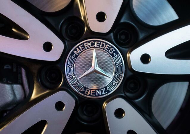 The logo of Mercedes-Benz is seen on the wheel of the new version of A-Class car during its launch in Mumbai