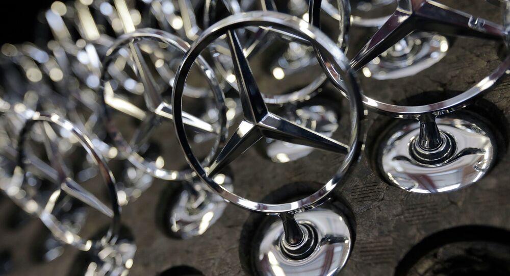 Car emblemsof a Mercedes-Benz S-class models lie at the plant in Sindelfingen, Germany