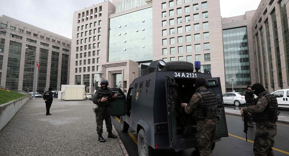 Members of special security forces stand outside the main courthouse in Istanbul, Turkey, Tuesday, March 31, 2015.