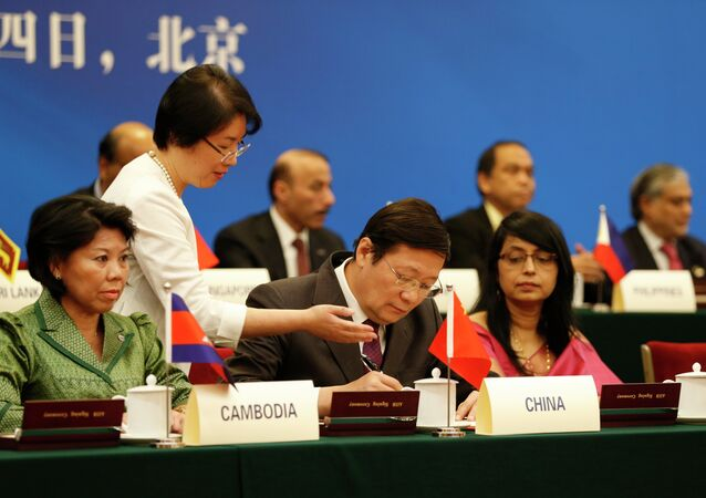 Chinese Finance Minister Lou Jiwei (C) at the signing ceremony of the Asian Infrastructure Investment Bank at the Great Hall of the People in Beijing