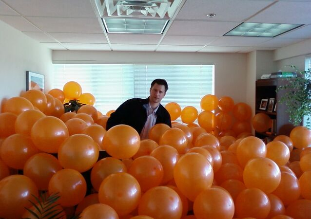 Balloons prove to be a perfect filler for a colleague's office, upholding the holiday spirit and making it impossible to reach their desk.