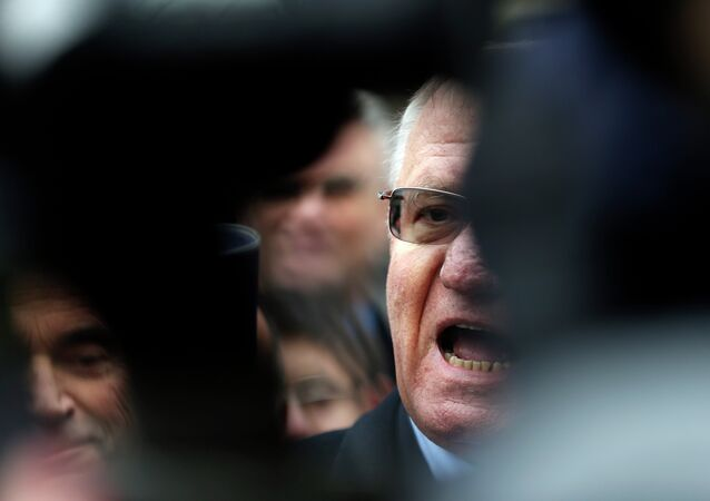 Serbian ultra nationalist leader Vojislav Seselj speaks during the protest in front of the presidency building in Belgrade, Serbia, Wednesday, Dec. 10, 2014.
