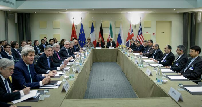 Officials wait for a meeting with officials from P5+1, the European Union and Iran at the Beau Rivage Palace Hotel March 31, 2015 in Lausanne.