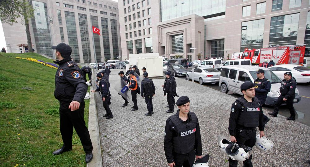 Turkish riot police stand guard outside the Justice Palace in Istanbul March 31, 2015.