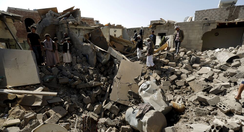 The rubble of houses destroyed by an air strike near Sanaa Airport