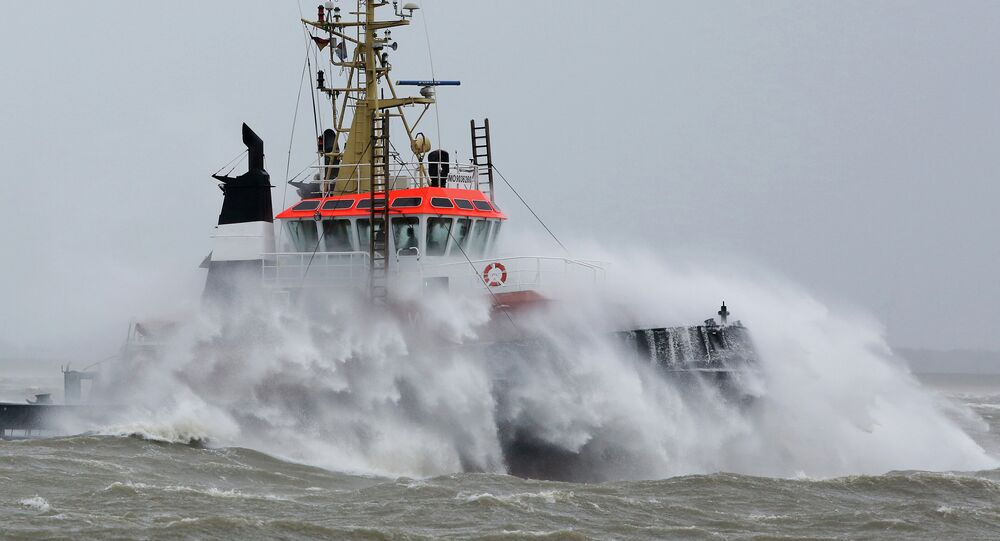 Waves crash against a towboat during heavy winds on the river Elbe near Brunsbuettel, northern Germany