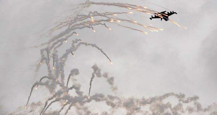 A Russian Yak-130 fighter jet shoots flares while perfoming a trick during the MAKS 2009 international aerospace show outside Moscow in Zhukovsky