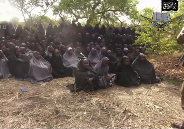 This Monday, May 12, 2014, file image taken from video by Nigeria's Boko Haram terrorist network, shows the alleged missing girls abducted from the northeastern town of Chibok. Islamic extremists in Nigeria have seized Chibok, forcing thousands of residents to flee the northeastern town from which the insurgents kidnapped nearly 300 schoolgirls in April.