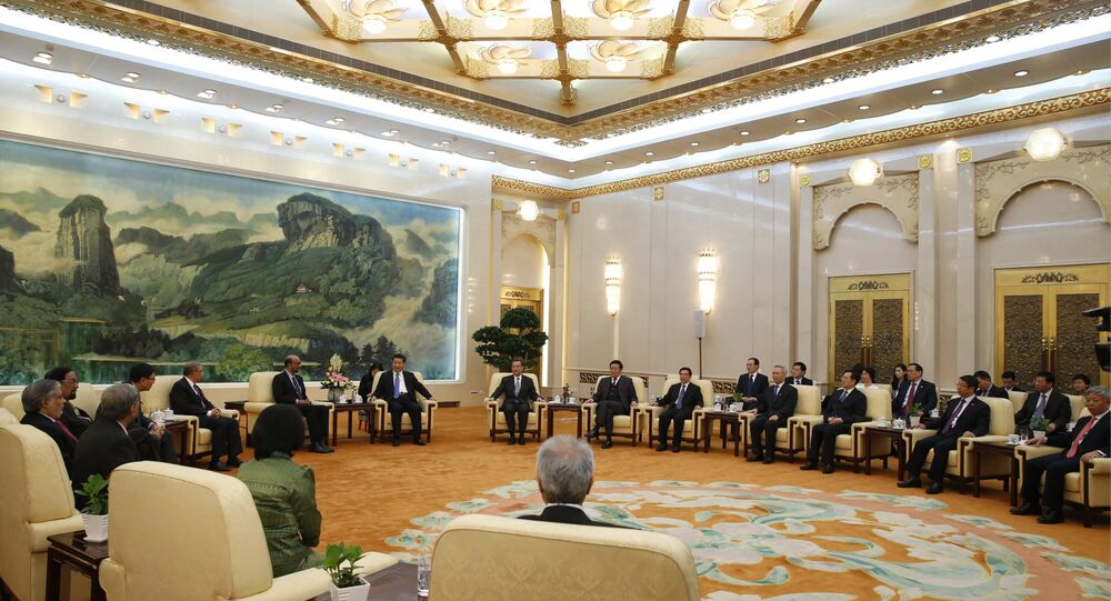 Chinese President Xi Jinping meets with guests of the Asian Infrastructure Investment Bank at the Great Hall of the People in Beijing