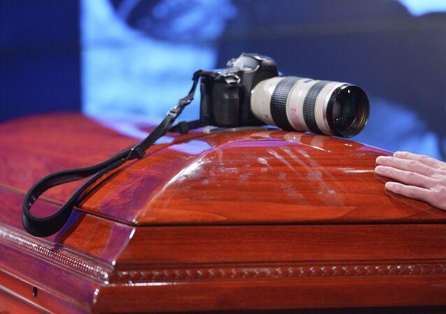 Mourning ceremony for the late photo journalist Andrei Stenin at the Rossiya Segodnya agency's press center.