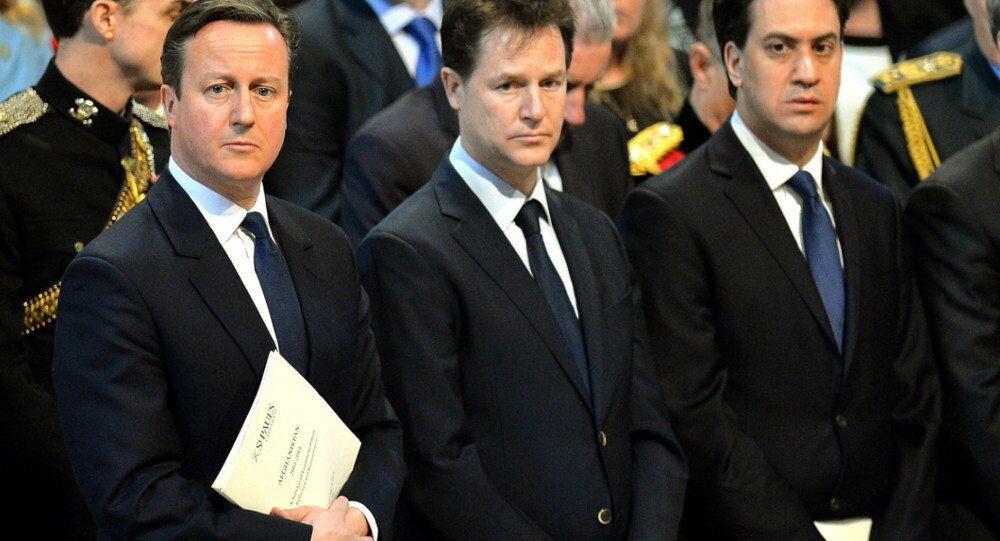 Britain's Prime Minister David Cameron, left, Deputy Prime Minister Nick Clegg, center, and Labour party leader Ed Miliband