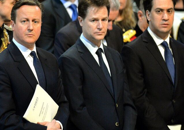 Britain's Prime Minister David Cameron, left, Deputy Prime Minister Nick Clegg, center, and Labour party leader Ed Miliband