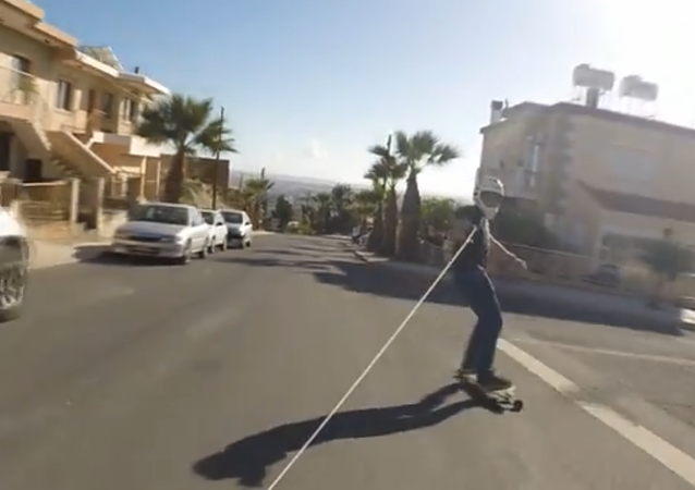 'Black Punisher' Skitches Car on Longboard