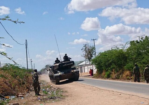 A Kenyan Defence Forces tank on a road outside the Garissa university college, Thursday, April 2, 2015.