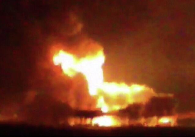 This frame grab of a video from the news station Noticias Ciudad del Carmen shows a fire burning at an oil platform in the Gulf of Mexico along the Mexican coast before sunrise on Wednesday, April 1, 2015.