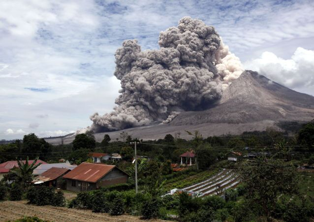 Mount Sinabung releases pyroclastic flows seen from Tiga Serangkai, North Sumatra, Indonesia