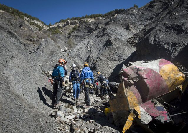 French emergency rescue services work among debris of the Germanwings passenger jet at the crash site near Seyne-les-Alpes, France