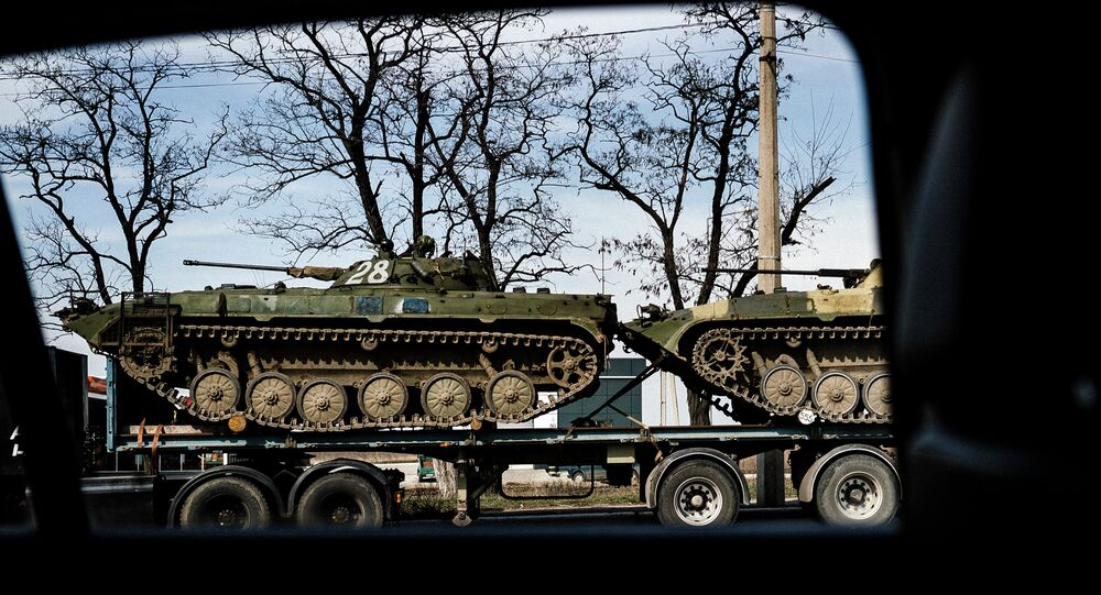 Armour Personnel Carriers loaded on a truck in the eastern Ukrainian city of Donetsk.