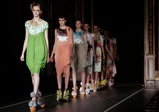 Models take to the runway after the presentation of Junko Shimada's Spring-Summer 2008 ready-to-wear fashion collection in Paris.