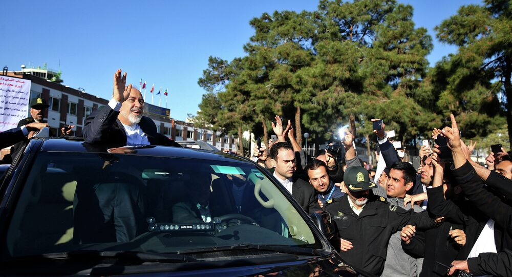 Iranian Foreign Minister Mohammad Javad Zarif, who is also Iran's top nuclear negotiator, waves to his well wishers upon arrival at the Mehrabad airport in Tehran, Iran, from Lausanne, Switzerland, Friday, April 3, 2015
