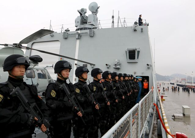 Soldiers of the Chinese People's Liberation Army stand on the deck before a fleet sets out for Aden, Yemen, from Zhoushan, Zhejiang province, April 3, 2015.