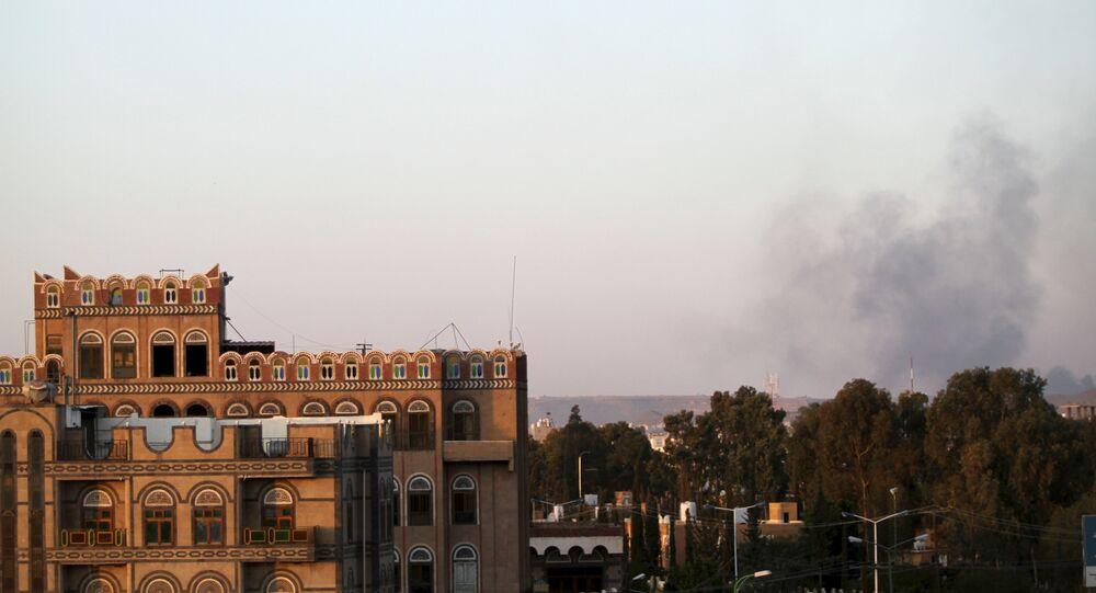Smoke billows near military barracks in the Jabal al-Jumaima mountain following an air strike near Sanaa