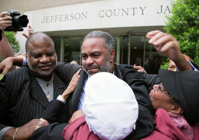 Friend Lester Bailey, left, and others greet Anthony Ray Hinton, center, as Hinton leaves the Jefferson County jail, Friday, April 3, 2015.