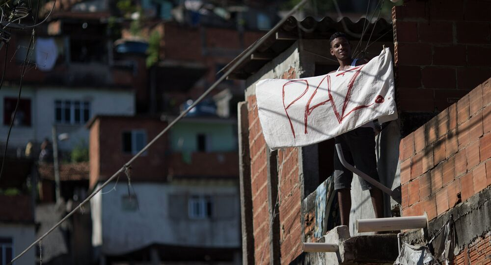 Police fired tear gas to disperse Rio de Janeiro favela residents Friday amid protests over the shooting death of a 10-year-old boy at the hands of officers, who claim a drug dealer shootout was to blame.