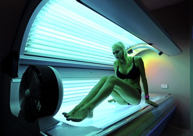 This photo taken on February 8, 2012 shows Lucinda Earlam, 20, preparing to lie down on a sunbed at a Solarium in Sydney's Dee Why