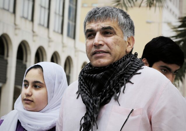 Bahraini human rights activist Nabeel Rajab (C) and his daughter Malak (L) leave a court building after attending his appeal hearing on February 11, 2015 in the capital Manama