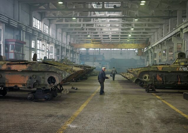 Employees work on armoured vehicles at an armor repair plant on September 23, 2014 in Zhytomyr, some 150kms west of Kiev