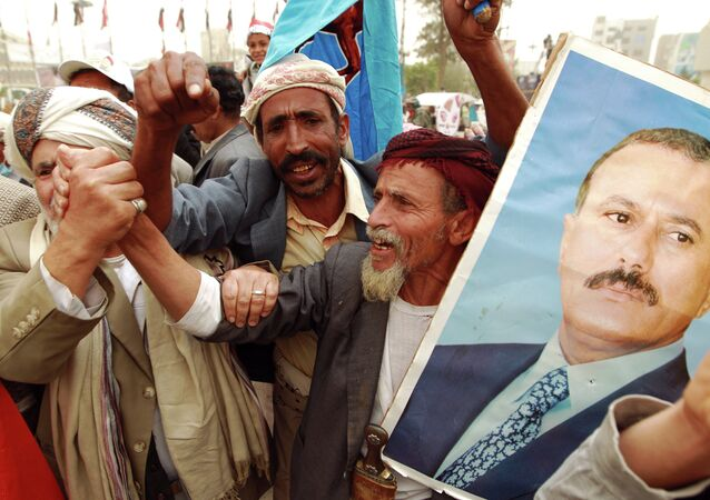Yemeni protesters hold a portrait of Yemen's former president Ali Abdullah Saleh during a demonstration against airstrikes carried out by the Saudi-led Arab coalition against Huthi militia in the capital Sanaa on April 3, 2015