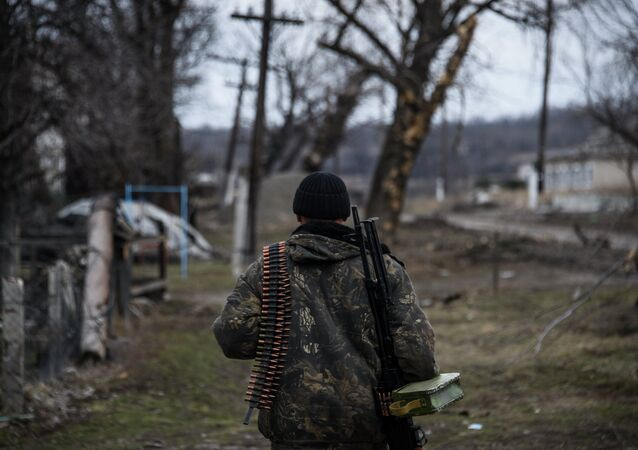 Independence supporter  walks along their position at the frontline in a village not far form Luhasnk, eastern Ukraine, Thursday, March 12, 2015
