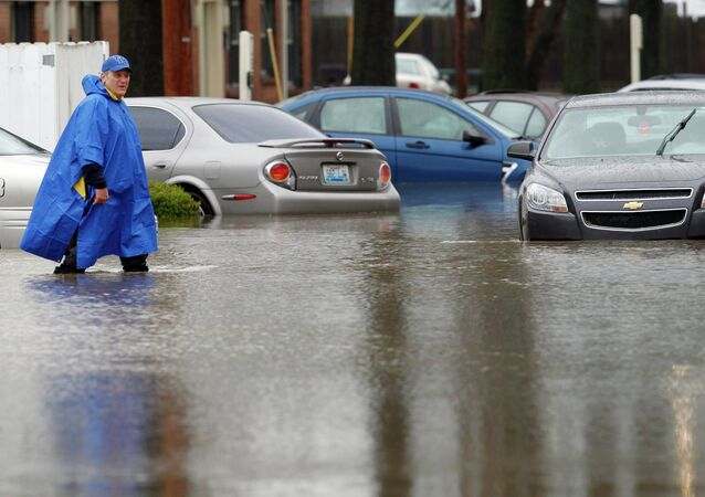 A resident of the Guardian Court Apartments wades through high water after heavy rains caused flash flooding and forced some to leave their homes in Louisville, Kentucky