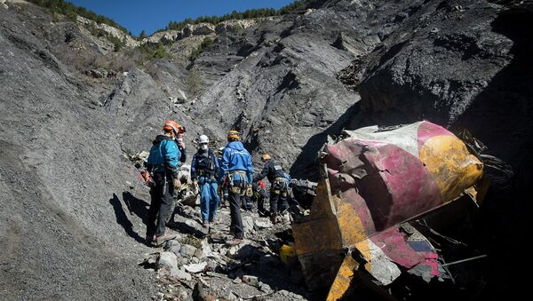 Rescue workers and investigators, seen in this picture made available to the media by the French Interior Ministry April 1, 2015, work near debris from wreckage at the crash site of a Germanwings Airbus A320, near Seyne-les-Alpes. - Sputnik International