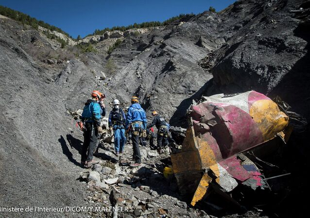 Rescue workers and investigators, seen in this picture made available to the media by the French Interior Ministry April 1, 2015, work near debris from wreckage at the crash site of a Germanwings Airbus A320, near Seyne-les-Alpes.
