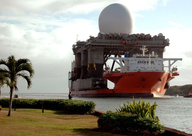 This image provided by the U.S. Navy shows the heavy lift vessel MV Blue Marlin entering Pearl Harbor, Hawaii with the Sea Based X-Band Radar (SBX) aboard Jan. 9 2006