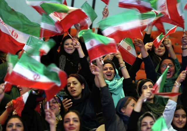 Iranian women wave Iranian flags during a ceremony of farewell for their national soccer team ahead of the 2014 World Cup in Brazil