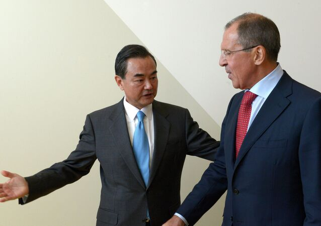 Russian Foreign Minister Sergey Lavrov, right, and Foreign Minister of China Wang Yi meeting during the Ministerial Week of the 68th session of the UN General Assembly