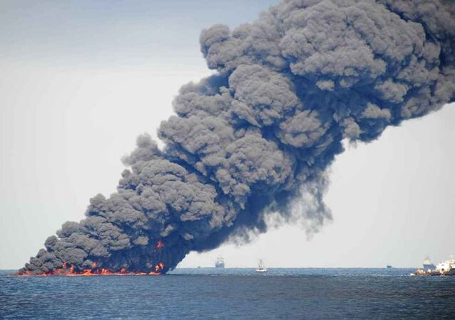 Spill-response crews gathering and burning oil in the Gulf of Mexico near the site of the leaking Macondo well
